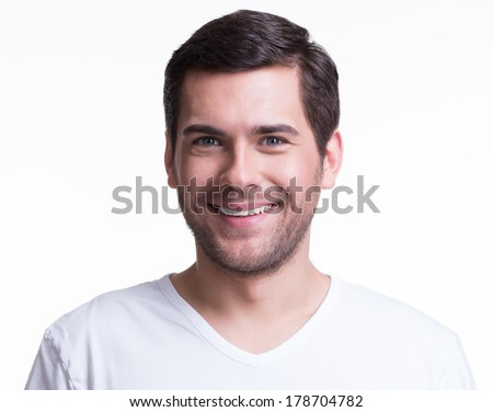 Portrait of handsome smiling young man in a white t-shirt - isolated on white.