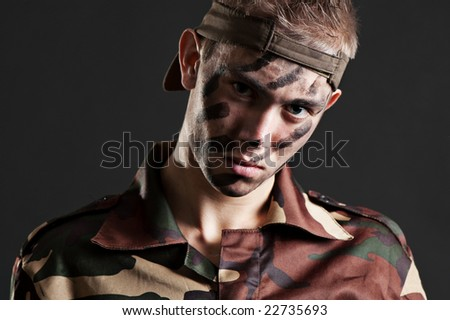 portrait of handsome soldier over dark background