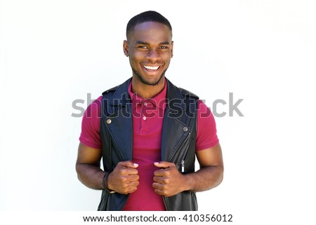 Portrait of handsome young  african guy smiling in black leather jacket on white background - stock photo