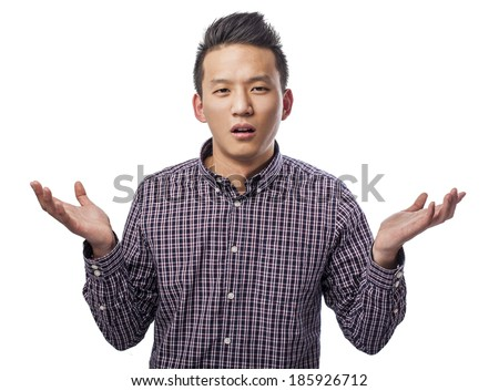 portrait of handsome young asian man dubting - stock photo