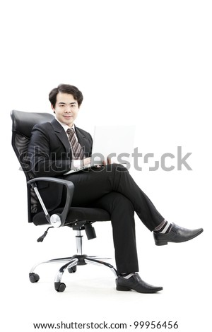 Portrait of handsome young business man using new laptop