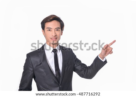 Portrait of handsome young businessman with hands gesture