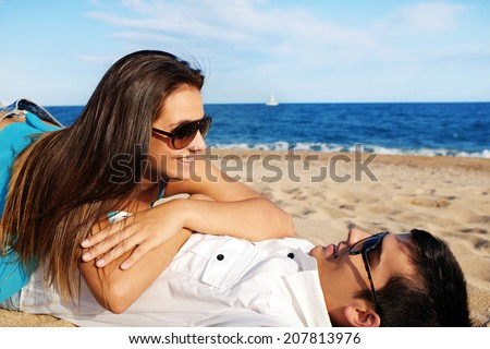 Portrait of handsome young Couple spending time on beach - stock photo