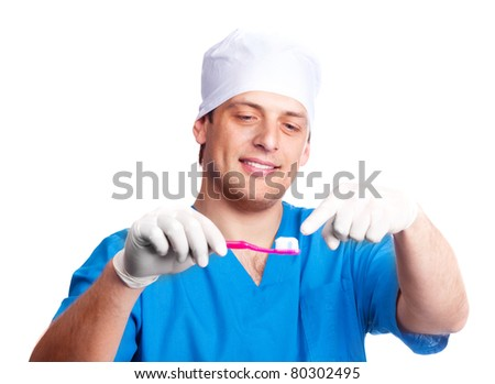 portrait of handsome young dentist teaching a patient to brush teeth, isolated against white background