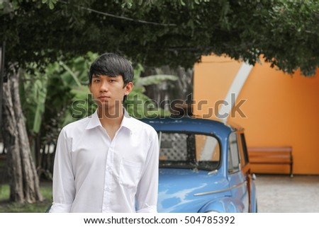 Portrait of handsome young man, front are  car