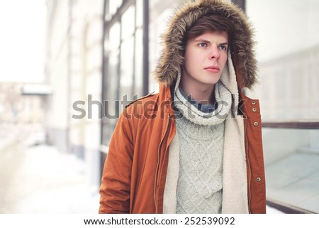Portrait of handsome young man in the city, street fashion concept