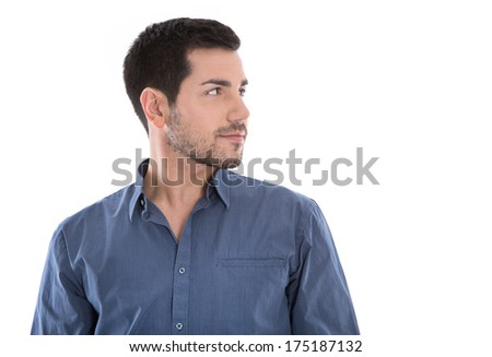 Portrait of handsome young man looking sideways in blue shirt isolated on white.  - stock photo