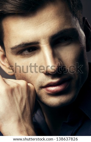 Portrait of handsome young man, sexy guy looking at camera - stock photo
