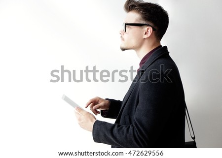 Portrait of handsome young man using his digital tablet. Isolated on white.