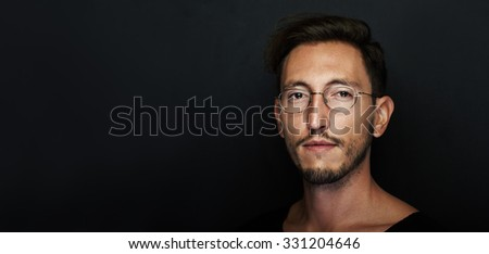 Portrait of handsome young man wearing glasses. Wide