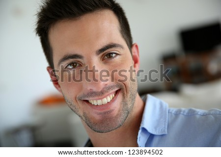 Portrait of handsome young man with blue shirt - stock photo