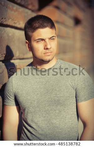 Portrait of handsome young muscular man in urban context