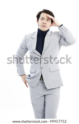 Portrait of handsome young thoughtful businessman isolated over white background - stock photo