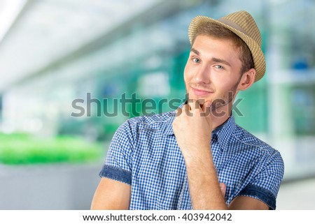 Portrait of handsome young thoughtful man - stock photo