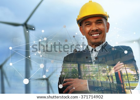 Portrait of happiness Asian engineer at wind turbine site. Double layers interior in concept of energy and ecological. - stock photo