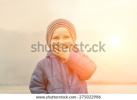 Portrait of happiness child outdoor under sun light - stock photo