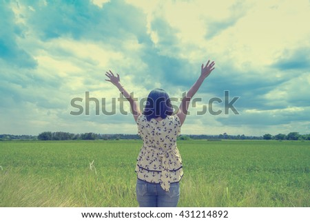 portrait of happiness woman stays outdoor with sky background,cheering woman hiker open arms - stock photo
