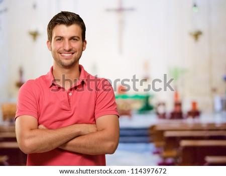 Portrait Of Happy A Man Standing In Church - stock photo
