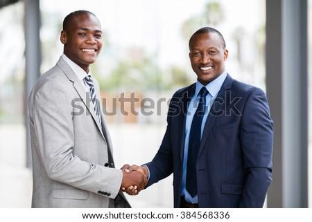 portrait of happy african american businesspeople handshaking - stock photo