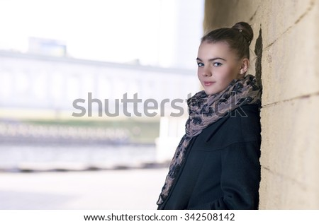 Portrait of Happy and Smiling Positive Caucasian Female Teenager Posing in Casual Clothing Outdoors. Horizontal Composition - stock photo