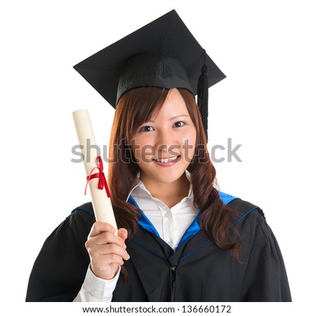 Portrait of happy Asian female student in graduate gown holding graduation diploma isolated on white background - stock photo