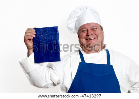 Portrait of happy attractive cook with book - stock photo