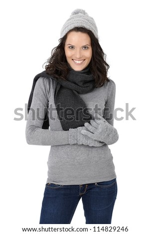 Portrait of happy attractive woman in winter clothes, scarf, cap and gloves, isolated on white. - stock photo