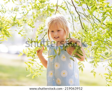 Portrait of happy baby girl in foliage