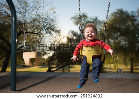 Portrait of Happy Baby in Swing - stock photo