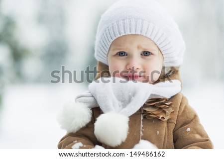 Portrait of happy baby in winter park