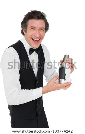 Portrait of happy bartender using cocktail shaker against white background - stock photo