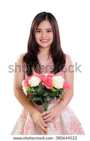 Portrait of happy beautiful Asian teenage girl holding a bouquet of roses, isolated on white background - stock photo