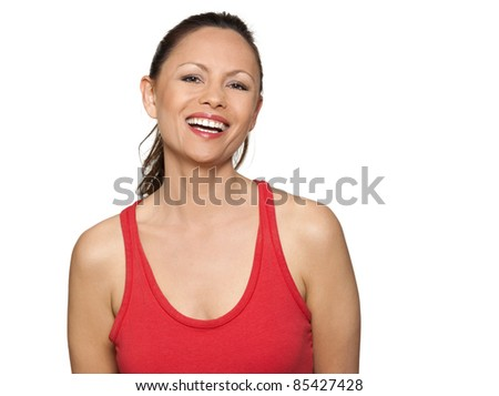 Portrait of happy beautiful Asian woman laughing in studio isolated on white background - stock photo