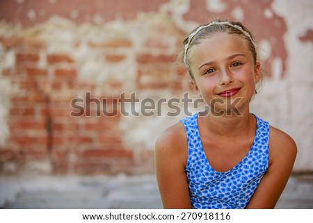 Portrait of happy beautiful young girl in summer dress  - stock photo
