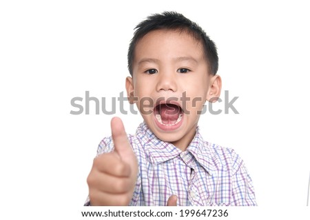 Portrait of happy boy showing thumbs up gesture