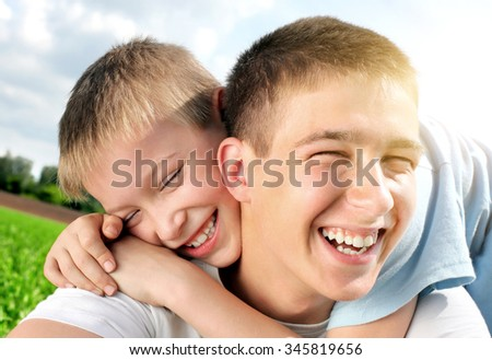Portrait of Happy Brothers in the Summer Field - stock photo