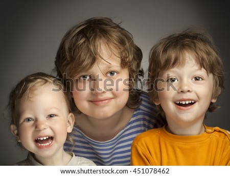 portrait of happy brothers on a gray background