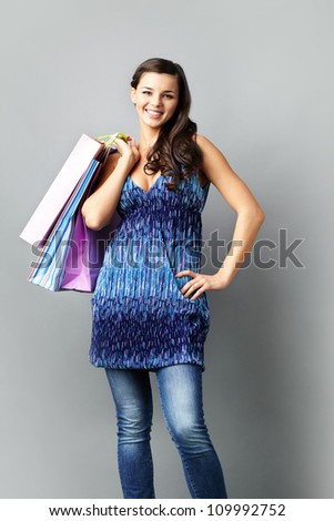 Portrait of happy brunette with paperbags looking at camera