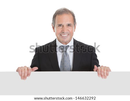 Portrait Of Happy Business Man Holding Blank Placard On White Background - stock photo