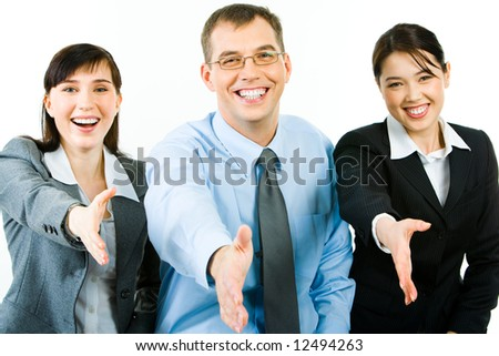 Portrait of happy business people giving hands to their partners and looking at camera - stock photo