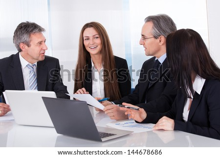 Portrait Of Happy Business People Working Together