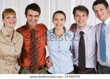 Portrait of happy business team standing together - stock photo