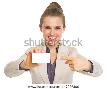 Portrait of happy business woman pointing on business card