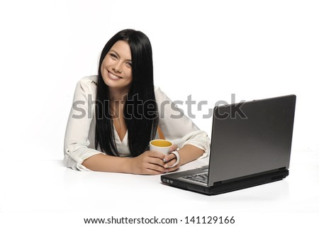 Portrait of happy business woman with a laptop