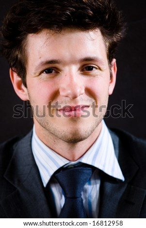 Portrait of happy businessman in suit, smiling. - stock photo
