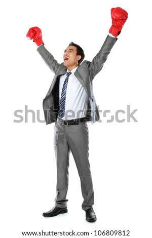 portrait of happy businessman with boxing glove raise his hand - stock photo