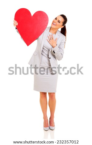 portrait of happy businesswoman with heart shape against white background - stock photo