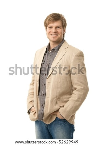 Portrait of happy casual young man standing with hands in pocket. isolated on white.