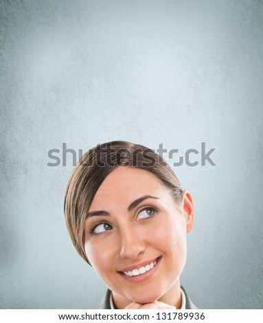 Portrait of happy Caucasian business woman standing over grunge background - stock photo