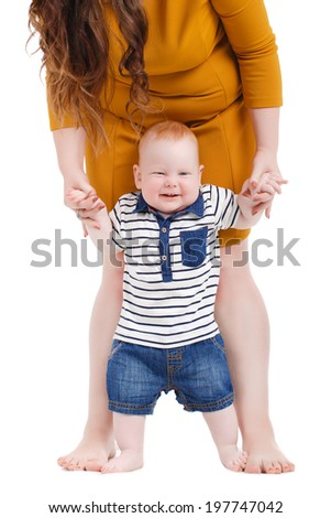 portrait of Happy cheerful family. Mother and baby kissing, laughing and hugging. Playful mood - stock photo